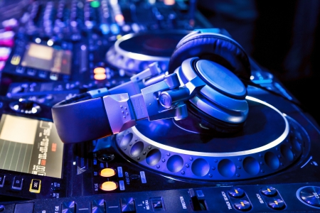 jockey: Dj mixer with headphones at nightclub