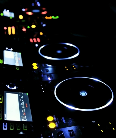 DJ CD player and mixer in nightclub photo