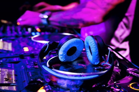 dj turntable: Dj mixes the track in nightclub at party  DJ headphones