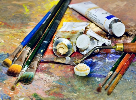 creativity artist: Artistic equipment  paint, brushes, spatula and art palette Stock Photo