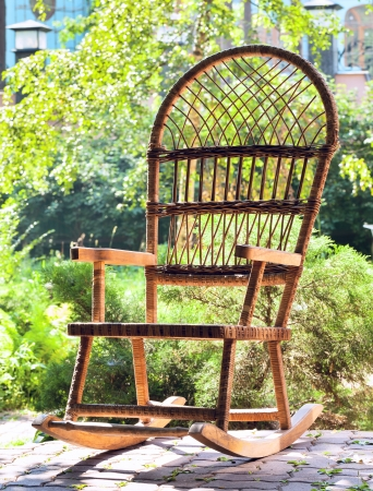 rocking chair: Rocking chair on porch of country house on background of summer garden