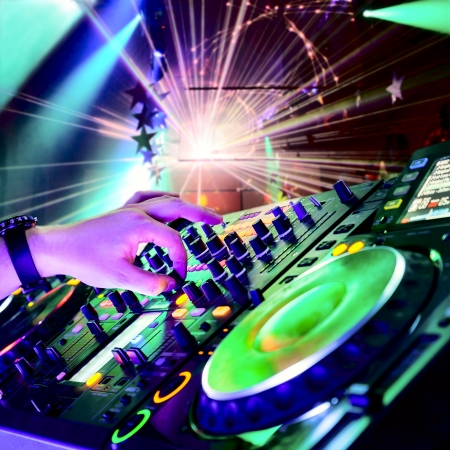 dancing disco: Dj mixes the track in the nightclub at party