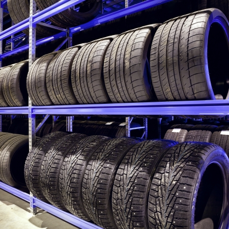 tire: Stack of car tires on warehouse closeup