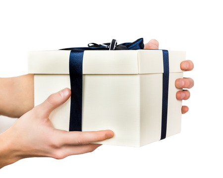 blue gift box: White gift box tied with blue ribbon in hands of men Isolated on white background