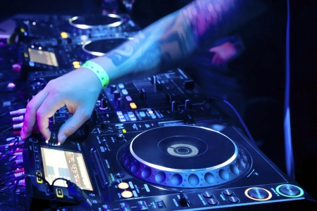 Dj playing the track in nightclub at party Stock Photo