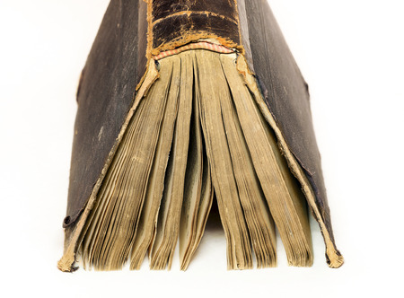 book binding: Thick old book on the white background Stock Photo