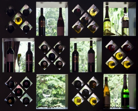 Wine collection on wooden shelves with bottles and glasses