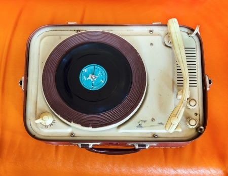turntables: Retro portable turntable on orange background Stock Photo