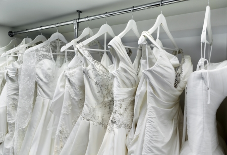 Collection of wedding dresses in the shop photo
