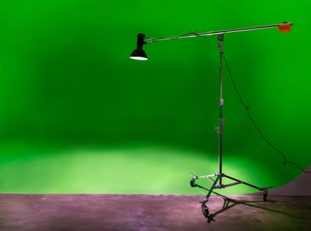 stripbox: Green or chroma key backdrop in empty Photo Studio with lighting