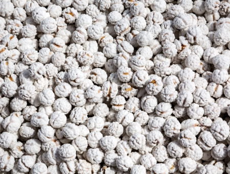 sugarcoated: White dragee, sugar covered nuts background