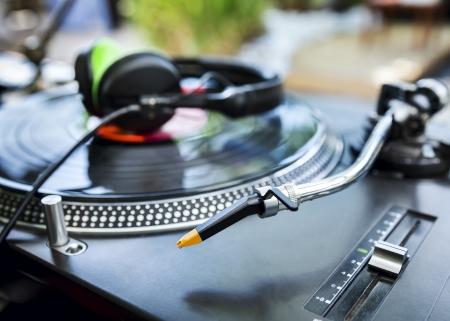 dj mixer: Dj mixer and Vinyl Player with headphones at club. Soft focus