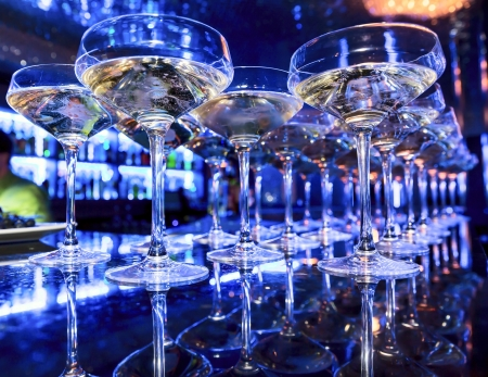 vesicles: Glasses of champagne at the bar in festive evening. Soft focus