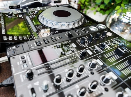 dj turntable: DJ CD player and mixer in a nightclub in daylight Stock Photo
