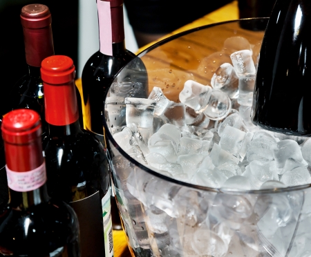 wine and dine: Bottles of red wine on ice in glass container