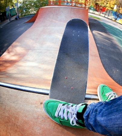 Skateboarder legs before jumping in the halfpipe.  Shooting fisheye lens optics photo