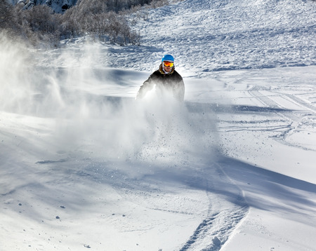 moving down: Freerider snowboarder moving down in snow powder