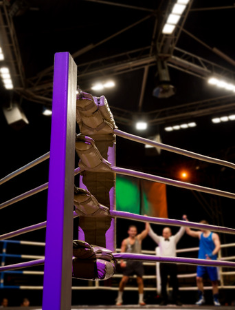 bandwagon: Referee raises his hand on championship equal victory boxers in the ring