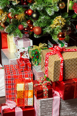 decorated christmas tree and holiday gift boxes with ribbons stock photo 25721479