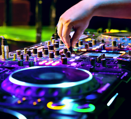 Dj mixes the track in nightclub at party photo