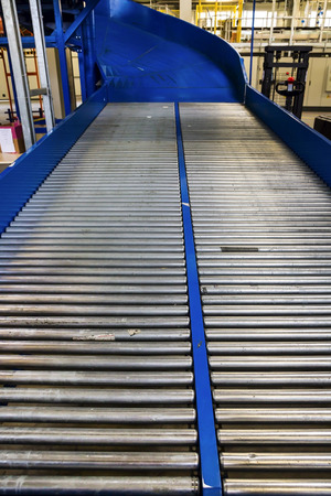Factory roller conveyor system for transporting crates photo