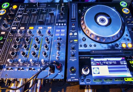cd player: DJ CD player and mixer in nightclub Stock Photo