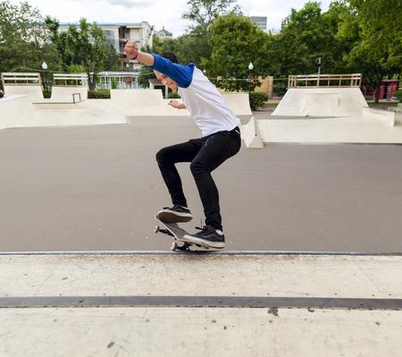 halfpipe: Skateboarder jumping in halfpipe at the skatepark