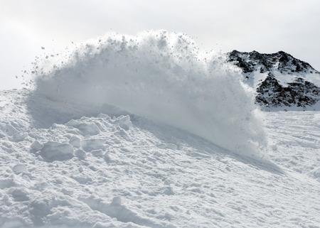 powder snow: Freerider snowboarder moving down in snow powder