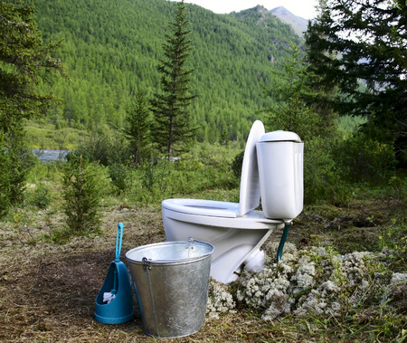 latrine: Ceramic new toilet in the woods in the mountains