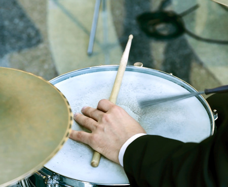 percussion: Hand of the drummer playing on drum set Stock Photo