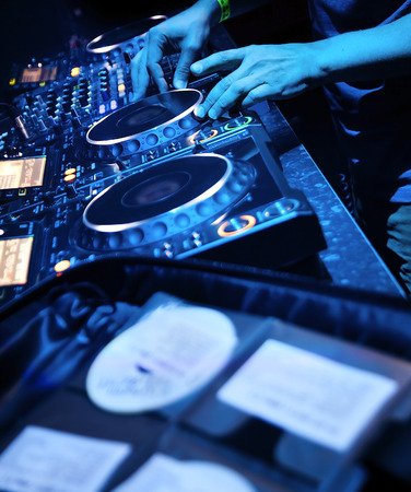 jockey: Dj mixes the track in the nightclub at party