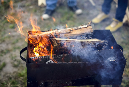 whiff: Birch firewood burning in the brazier for cooking