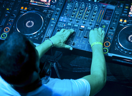 dj mixer: Dj mixes the track in the nightclub at party  Top view