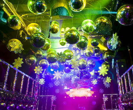 Colorful lights and disco balls decorations for Christmas at nightclub photo