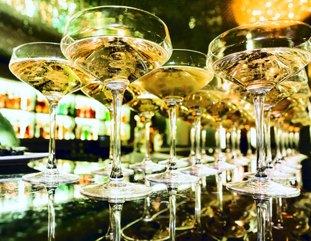 Glasses of champagne at the bar in festive evening