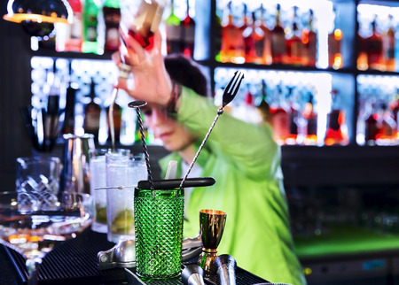 cocktail strainer: Barman professional making cocktail drinks in background Stock Photo
