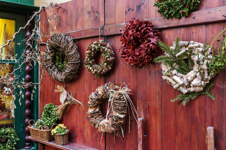 door leaf: Traditional design of a christmas wreaths attached to the door of old house from different natural materials