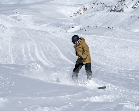 ski traces: Freerider snowboarder moving down in snow powder