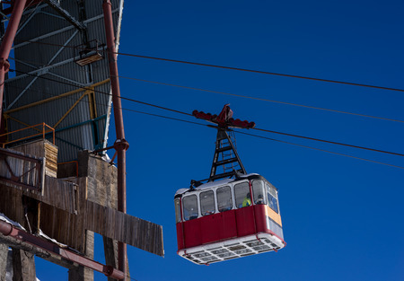 cableway: Old pendulum cableway for transport large numbers of people in mountains Caucasus on background blue sky