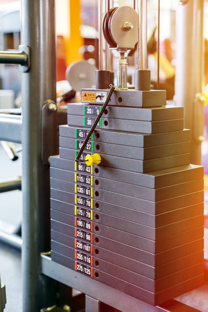 kilos: Closeup weight of stack in a gym Stock Photo