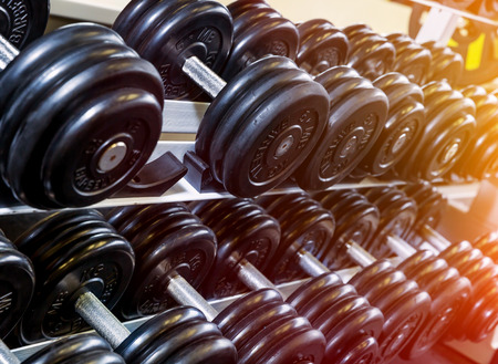 powerlifting: Stand holder for dumbbells in the gym. Soft focus