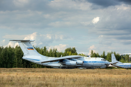aerodrome: MOSCOW, RUSSIA - AUGUST 16: Old russian aircrafts at the abandoned aerodrome in summertime. Cemetery of large and small aircraft near the runway on August 16, 2014 in Zhukovsky, Moscow region, Russia