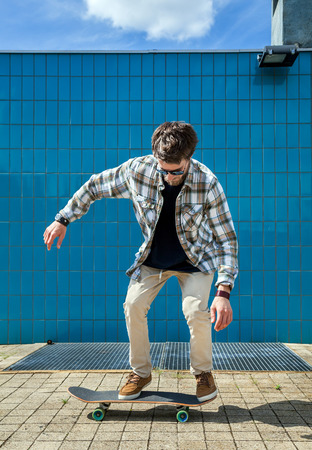 ���wall tiles���: Skateboarder jumping in city on skateboard at the background wall tiles