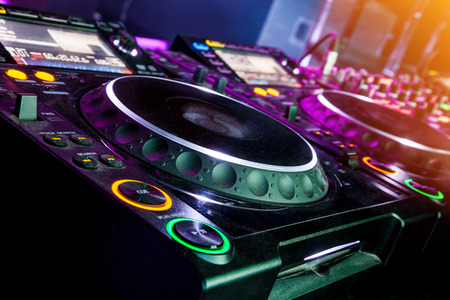 dj party: DJ CD player and mixer in nightclub Stock Photo