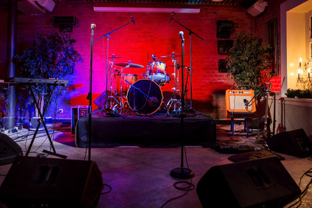 Rock concert stage with musical instruments in nightclub