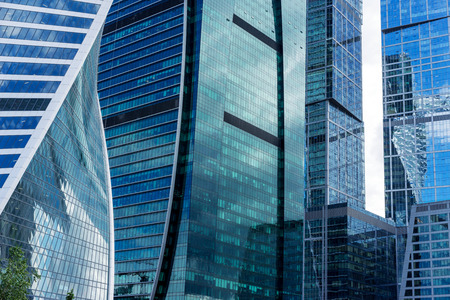 business center: MOSCOW. RUSSIA - JUNE 5, 2015: Skyscrapers of the Moscow city business center close-up. Moscow International Business Center also referred to as Moscow-City is a commercial district in central Moscow, Russia
