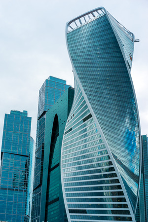 referred: MOSCOW. RUSSIA - JUNE 5, 2015: Skyscrapers of Moscow city business center closeup. Moscow International Business Center also referred to as Moscow-City is commercial district in central Moscow, Russia