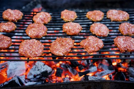 barbequing: Grilled burgers on a barbecue grill close-up