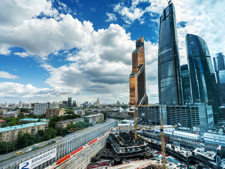 commercial district: MOSCOW. RUSSIA - JUNE 5, 2015: Skyscrapers of Moscow city business center closeup. Moscow International Business Center also referred to as Moscow-City is commercial district in central Moscow, Russia