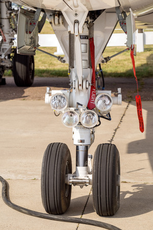 chassis: Landing gear. Front part of chassis of aircraft closeup